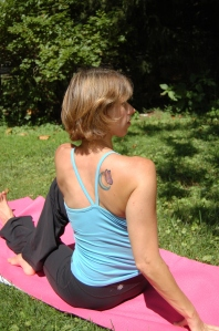 Keep space under the ears in Paripurna Matsyendrasana (Seated Spinal Twist).